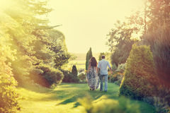 Young beautiful couple walking in a summer park Royalty Free Stock Images