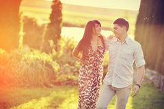 Young beautiful couple walking in a summer park Stock Images