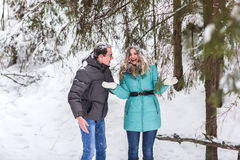 Young beautiful couple walking in winter forest Stock Photography