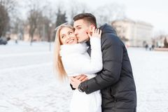 Young beautiful couple in the winter cold day walking in the cit Royalty Free Stock Images