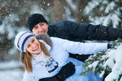 Young beautiful couple in winter park. Portrait of young beautiful couple in winter park Royalty Free Stock Image