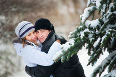 Young beautiful couple in winter park. Stock Images