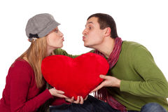 Young Beautiful Couple With Red Heart Royalty Free Stock Images