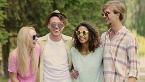 Young beautiful couples joking and laughing in summer camp, holidays, fun. Stock footage stock video footage