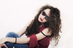 Young beautiful curly brunette woman in sunglasses Stock Photo