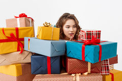 Young beautiful curly girl among gift boxes Isolated Royalty Free Stock Photography