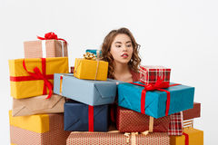 Young beautiful curly girl among gift boxes Isolated Stock Images