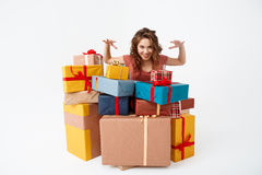 Young beautiful curly girl among gift boxes Isolated Stock Photos