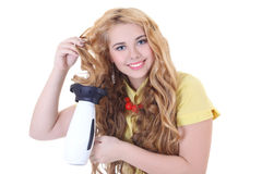 Young beautiful curly woman with hairdryer Royalty Free Stock Photography