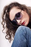 Young beautiful curly woman in sunglasses Royalty Free Stock Images