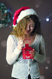 Young beautiful cute girl smiling, standing and holding lantern in hand on background of Christmas decorations royalty free stock photography