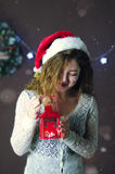 Young beautiful cute girl smiling, standing and holding lantern in hand on background of Christmas decorations.  Royalty Free Stock Photography