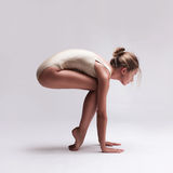 Young beautiful dancer in beige swimsuit Stock Image