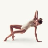 Young beautiful dancer in beige swimsuit Royalty Free Stock Images