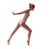 Young beautiful dancer in beige swimsuit Royalty Free Stock Photos