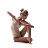 Young beautiful dancer in beige swimsuit Stock Photography
