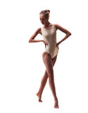 Young beautiful dancer in beige swimsuit Stock Photo