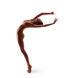 Young beautiful dancer in beige swimsuit posing Royalty Free Stock Photography