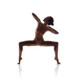 Young beautiful dancer in beige swimsuit posing Royalty Free Stock Photo