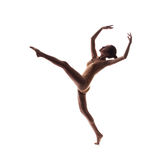 Young beautiful dancer in beige swimsuit posing Stock Images