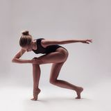 Young beautiful dancer in black swimsuit Royalty Free Stock Photos