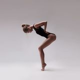 Young beautiful dancer in black swimsuit Stock Photo