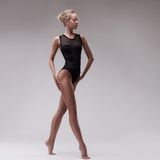 Young beautiful dancer in black swimsuit Stock Images