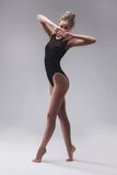Young beautiful dancer in black swimsuit Stock Photos