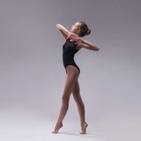 Young beautiful dancer in black swimsuit Royalty Free Stock Photography