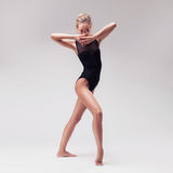 Young beautiful dancer in black swimsuit Royalty Free Stock Images