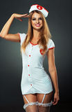 Young and beautiful dancer in nurse costume posing on studio Royalty Free Stock Image