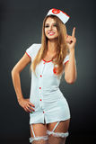 Young and beautiful dancer in nurse costume posing on studio Royalty Free Stock Photos