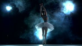 Young beautiful dancer posing on a blue background stock video