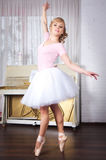 Young beautiful dancer posing in dance studio Royalty Free Stock Photography