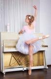 Young beautiful dancer posing in dance studio stock photos