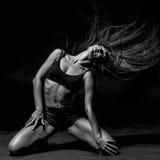 Young beautiful dancer posing in studio Stock Image