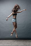 Young beautiful dancer posing in studio Royalty Free Stock Photography