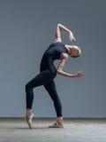 Young beautiful dancer posing in studio Stock Photos