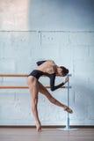 Young beautiful dancer posing in studio Stock Photo