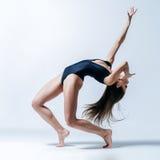 Young beautiful dancer posing in studio Stock Images