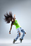 The dancer. Young beautiful dancer posing on a studio background Stock Images