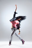 The dancer. Young beautiful dancer posing on a studio background stock image