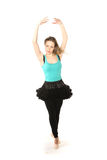Young beautiful dancer posing on a studio background Royalty Free Stock Photography