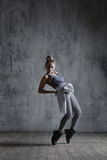 Young beautiful dancer is posing in studio royalty free stock photography