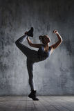 Young beautiful dancer is posing in studio royalty free stock photo