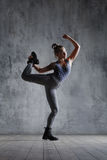 Young beautiful dancer is posing in studio stock photography