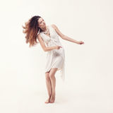 Young beautiful dancer in white dress posing Royalty Free Stock Image