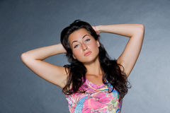 Young beautiful dark haired woman. Studio shot Royalty Free Stock Images
