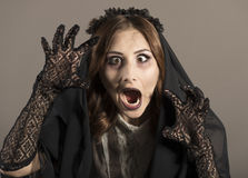 Young beautiful demonic female. royalty free stock photos