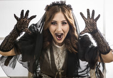 Young beautiful demonic female. Dead widow in grief. Dark Beautiful Gothic Princess. Halloween party Royalty Free Stock Photography